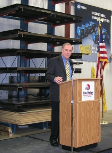 Technical Education Champion Mike Weller, president of Miller Electric Mfg. Co., discusses workforce training needs at FVTC's Advanced Manufacturing Technology Center in Oshkosh.
