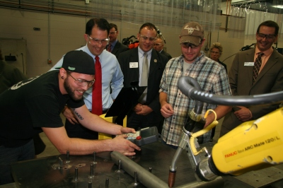 Governor Scott Walker observes students working on robotic welders at the Advanced Manufacturing Technology Center in Oshkosh.
