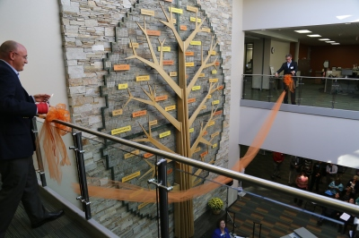 The second floor ribbon falls in front of the Tree of Success during the dedication of the Student Success Center.