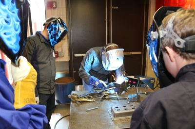 Students sparked their creativity in the welding lab.